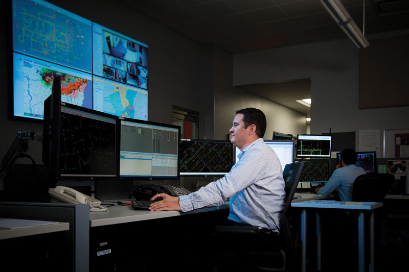 We invested in a state-of-the-art distribution management system to help us operate, maintain and optimize the function of the electric grid. MGE's Distribution Systems Operations Supervisor Ross Hewitt monitors the grid in our operations center.