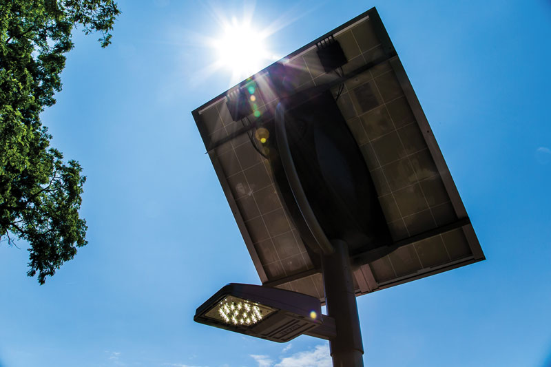 A photovoltaic panel captures the sun's energy and stores it in a battery to power the overhead light at night. MGE will offer customers the option of installing solar outdoor overhead lighting.