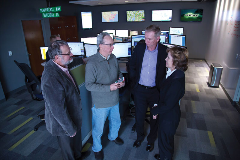 TrafficCast's operations center monitors cities across the nation. Meeting are (left to right) Nick Kiernan, TrafficCast Executive Vice President of Sales/Business Development; John Drury, MGE's Senior Business Development Manager; and Lorrie Heinemann, President of Madison Development Corp.