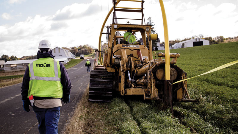 Crews install gas main along Woodland Drive in a rural area near the village of Waunakee under MGE's gas expansion program. The program extends natural gas service to new areas